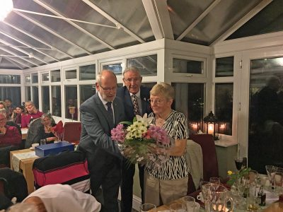 President Nigel Collins Presenting Jean Black With Flowers