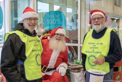 Santa with Rotarians Chris Lilley and Nigel Colins